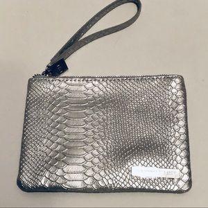 RODEN & FIELDS-silver cosmetic wristlet.